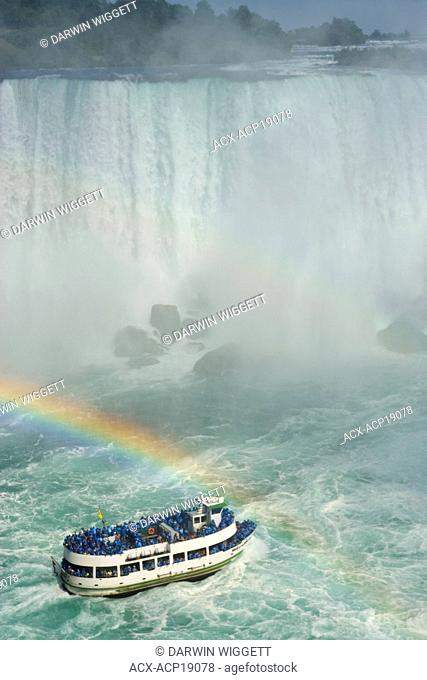 Maid of the Mist' and rainbow at the base of the American Falls viewed from Table Rock, Niagara Falls, Ontario, Canada