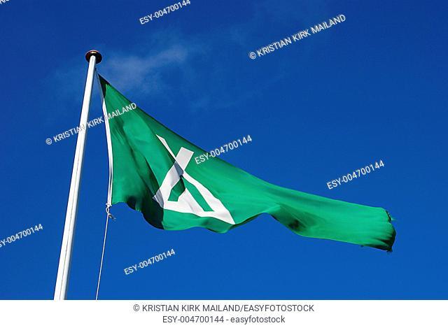 Camping flag waving aginst blue sky