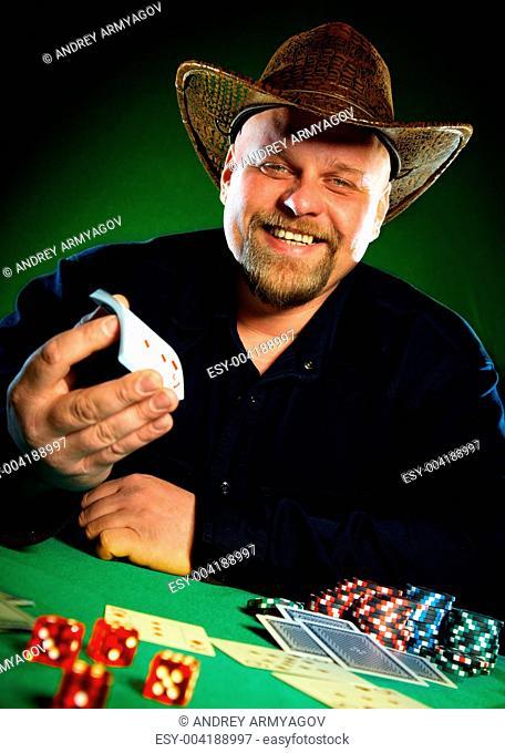 man with a beard plays poker