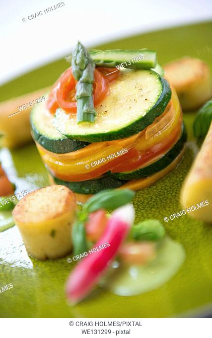 Mediterranean vegetable stack served in a fine dining restaurant with fondant potatoes