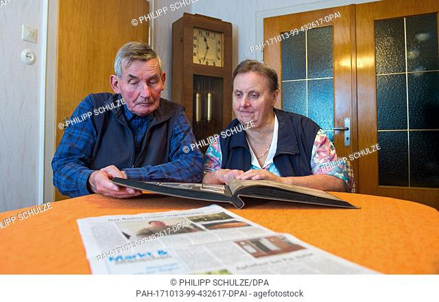 Wilhelm and Helga Rabe take a look at a family's photo album in Barum, Germany, 12 October 2017. Helga Rabe is the niece of the soldier Heinrich Held