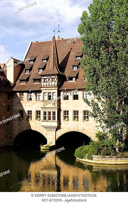 Germany Bavaria Nuremberg Heilig-Geist-Spital Old people's residences above the River Pegnitz