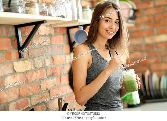 Lovely woman with delicious smoothie