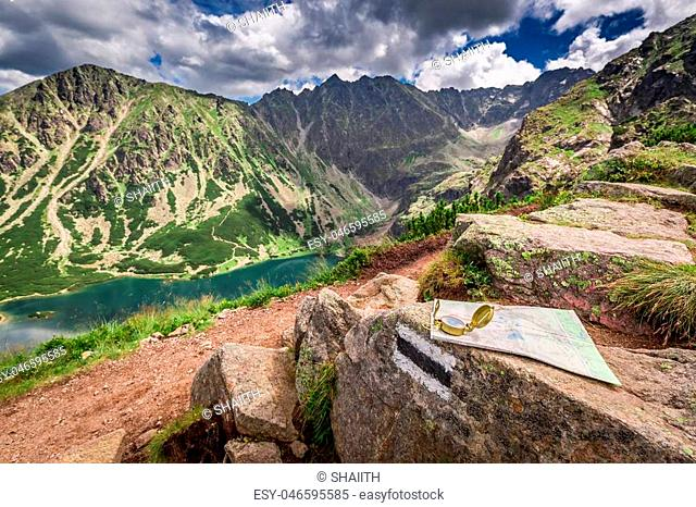 Navigation in Tatra mountains with compass nad map, Poland