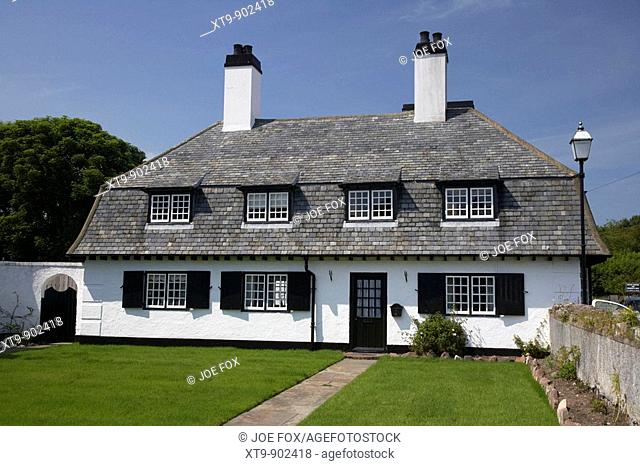 maud cottages whitewashed terraces in the village square cushendun county antrim northern ireland uk