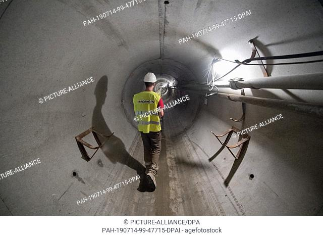 26 June 2019, Mecklenburg-Western Pomerania, Stolpe: View into the 1003 meters tunnel below the Peene valley. 256 concrete elements were continuously advanced...