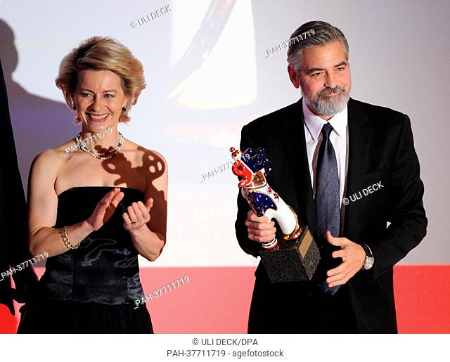German Minister of Labour and Employment Ursual von der Leyen (CDU) hands US actor George Clooney (R) the trophy, during the award ceremony for the German Media...