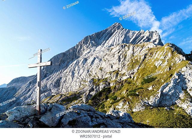 Summit cross and Mt. Alpspitze