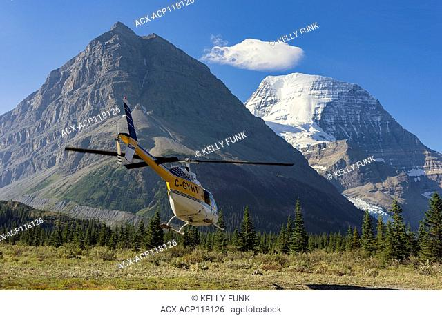 A helicopter chartering hikers in and out takes off from Snowbird pass campground, Mt. Robson Provincial Park, British Columbia, Thompson Okanagan region