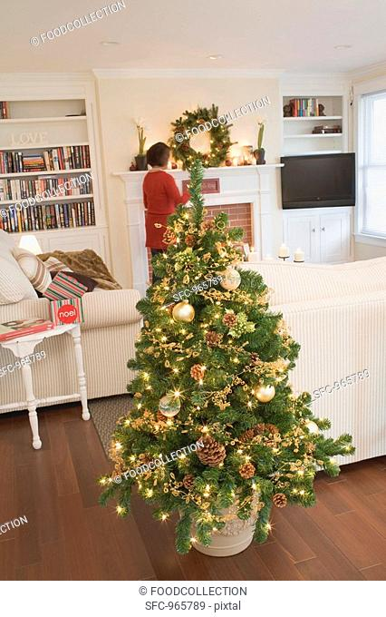 Woman in living room decorated for Christmas