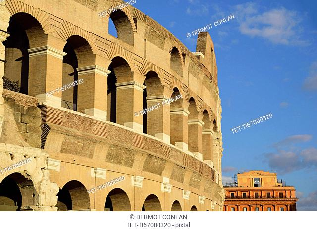 Facade of Coliseum against cloudy sky
