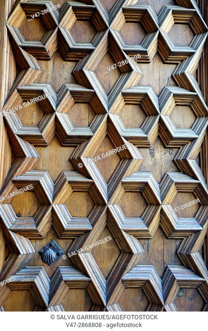 Detail of the wooden door of the Longa de la Seda, Valencia, Spain