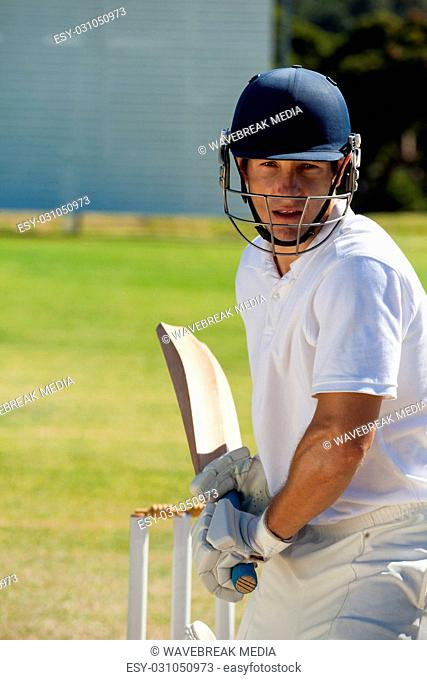 Player playing cricket on field