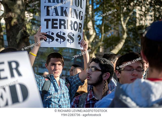 Hundreds of Jews and supporters protest in front of the Metropolitan Opera at Lincoln Center on opening night, Monday, September 22