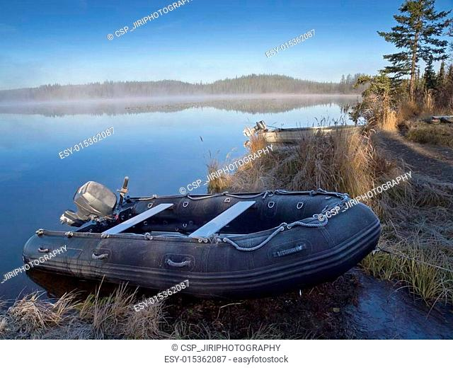 Frosty inflatable boat beached onto the shore of Morchua Lake