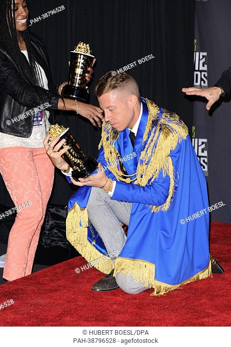 US musician Macklemore poses at the 2013 MTV Movie Awards Photo Pressroom at Sony Pictures Studios in Culver City, Los Angeles, USA, on 14 April 2013