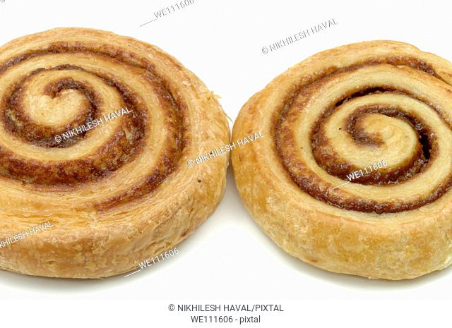 2 two Danish cinnamon whirl pastry on white background