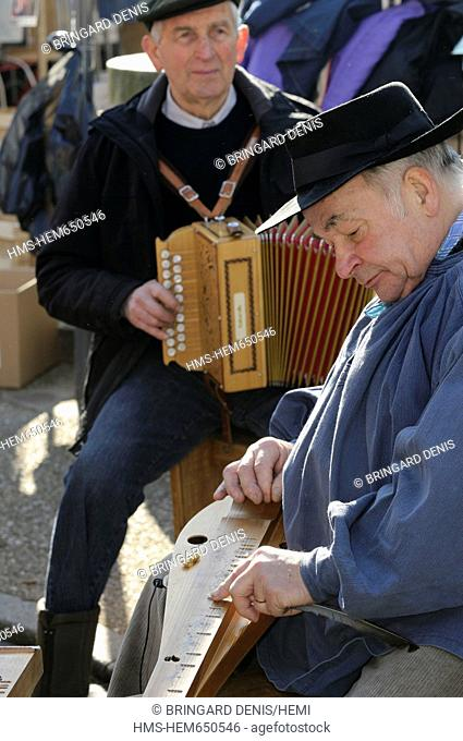 France, Vosges, Val d'Ajol, Andouilles Fair, the third Monday in February since 1831, cooking waffles on a wood stove 4 holes, regional tradition
