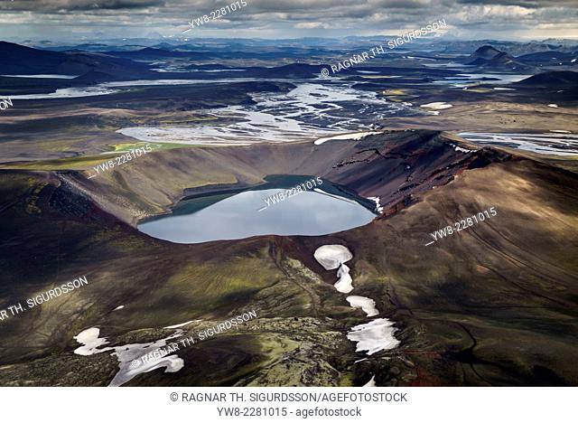 Aerial view of Blahylur crater lake, Landmannalaugar, Central Highlands, Iceland. Landmannalaugar located in the Fjallabak Nature Reserve is at the edge of...