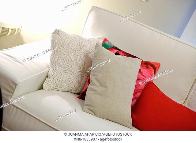Couch with colorful cushions