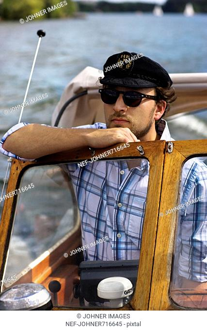 Man driving a motorboat, Sweden