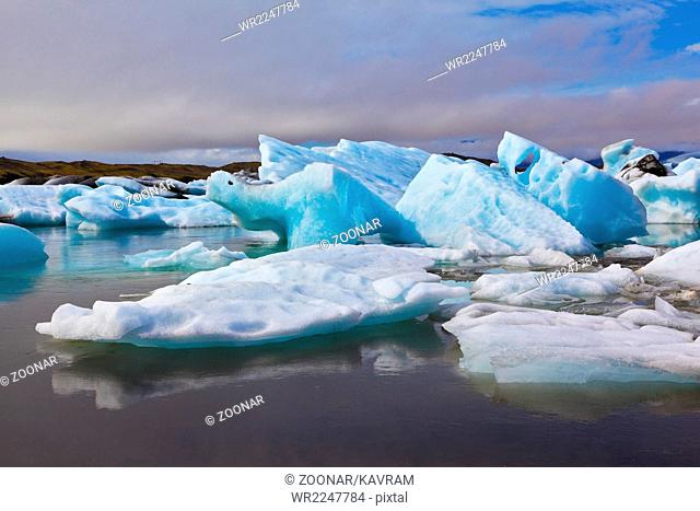 The ice floes are reflected in water