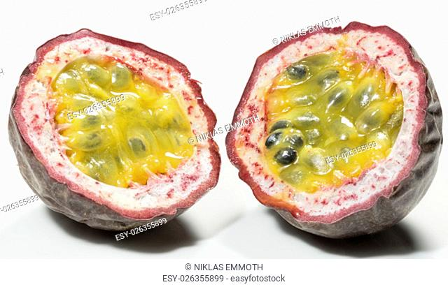 Passion Fruit Cut in Half close up on white background