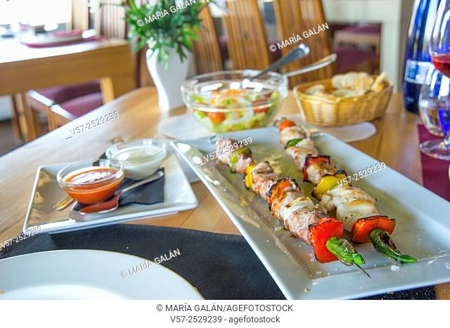 Brochette of meat and vegetables in a restaurant