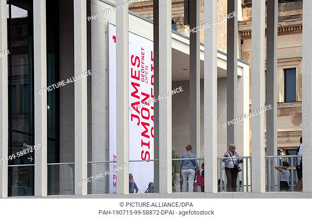13 July 2019, Berlin: visitors stand on the terrace of the James Simon Gallery. The National Museums have invited to the opening of the gallery a day of action