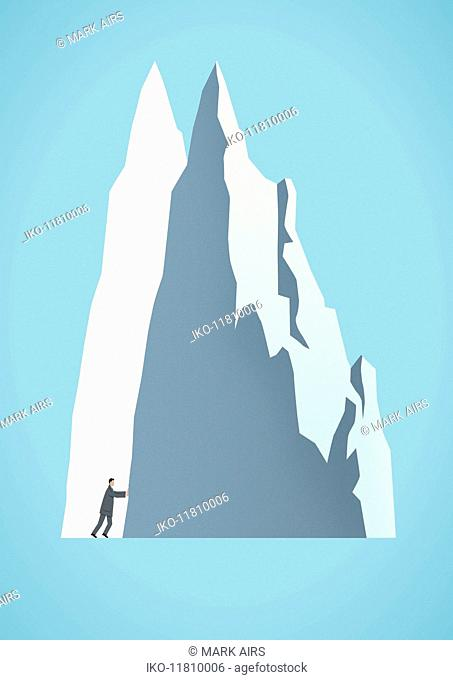 Businessman moving mountain