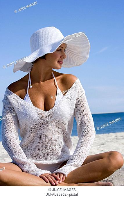Woman wearing sunhat at beach