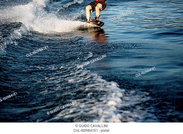 Cropped view of waterskier waterskiing, Maggiore lake, Verbania, Piedmont, Italy