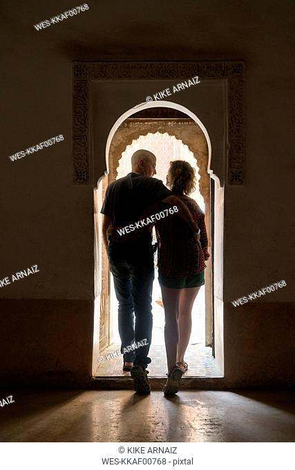 Morocco, Marrakesh, couple leaving building