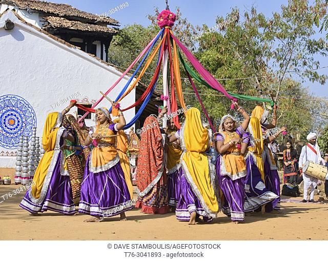 Women dancing at the Shilpgram Arts Festival, Udaipur, Rajasthan, India