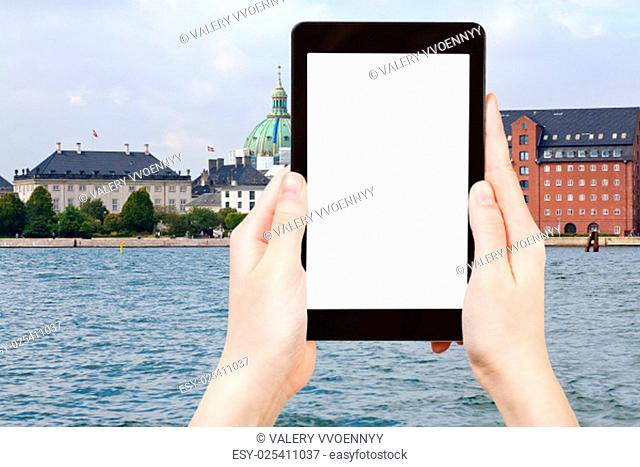 travel concept - tourist photograph waterfront, Marble Church and The Royal Cast Collection in Copenhagen, Denmark on tablet pc with cut out screen with blank...