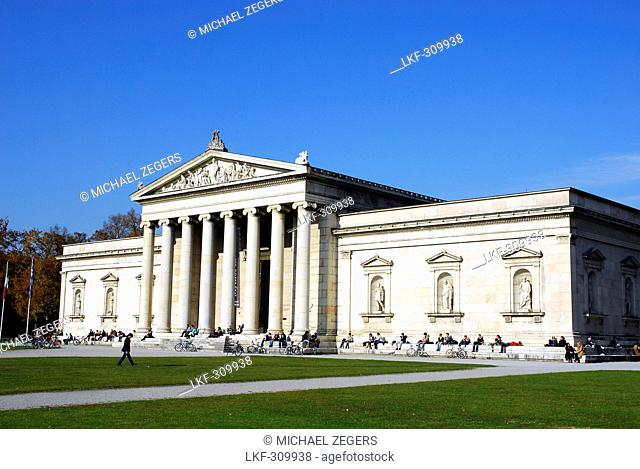People in front of the Glyptothek building, a museum of Greek and Roman sculptures from the ancient world, Koenigsplatz square, Maxvorstadt, Munich