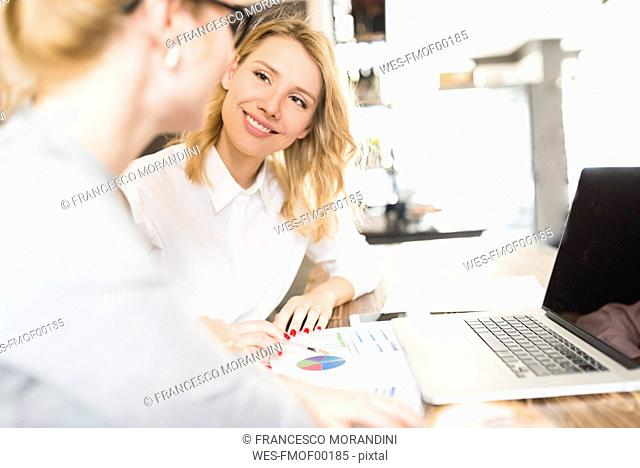 Two businesswomen working together on project