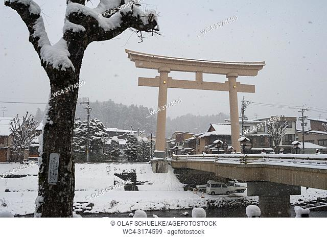 Takayama, Gifu, Japan, Asia - A view of the Miyamae Bashi Bridge with the big Torii gate at one side that marks the entrance to a Shinto shrine