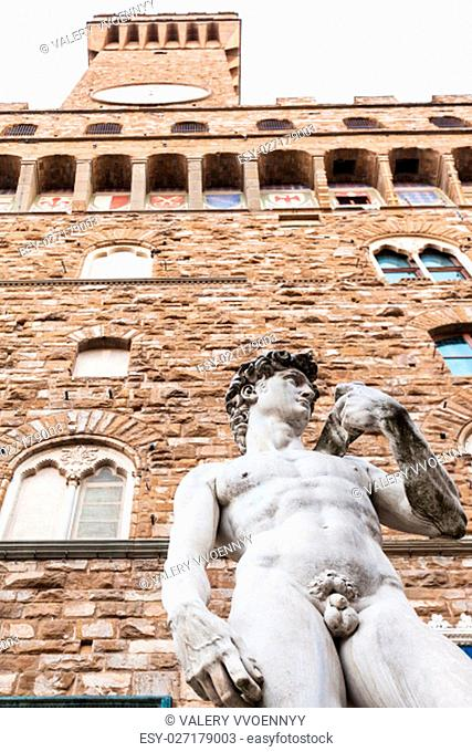 travel to Italy - bottom view of Copy of statue David near Palazzo Vecchio in Florence city. Original David is Renaissance sculpture created in 1501 - 1504 by...