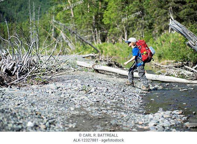 Young Boy Backpacking In Chugach State Park, Southcentral Alaska, USA