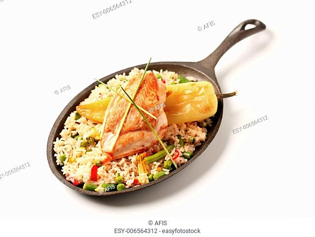 Fried rice and roasted chicken breast on a skillet