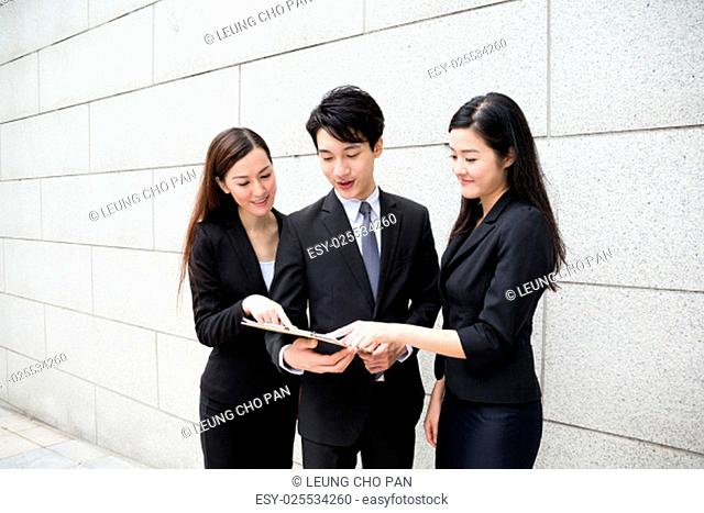 Group of business people work together