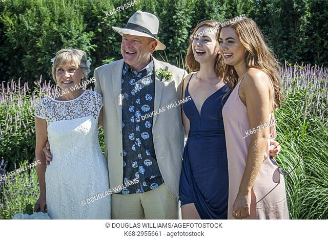 A senior couple and his daughters at an outdoor wedding in West Vancouver, BC, Canada