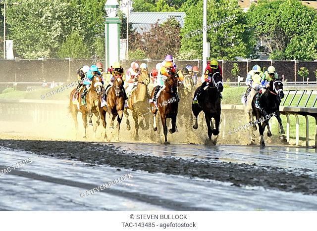 At The First Pole, at Churchill Downs 143 Running of The Kentucky Derby on May 6, 2017 in Louisville, Kentucky, Horizontal, Jockeys riding