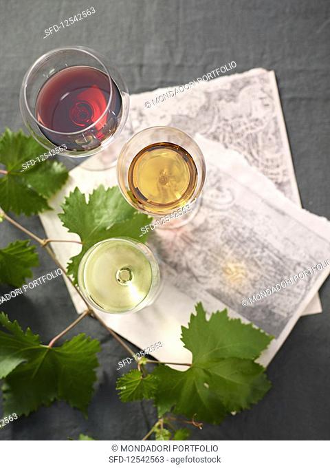 Red wine, white wine and passito in glasses