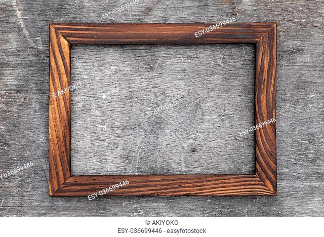 grain wood picture frame on grunge background