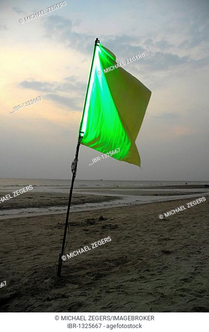 Sunset, green flag at White Sand Beach, Hat Had Sai Khao, Koh Chang Island, National Park Mu Ko Chang, Trat, Gulf of Thailand, Thailand, Asia