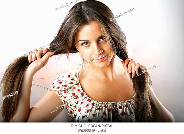 Studio Shot of girl clutching the long hair