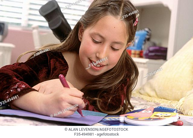 Young Girl Drawing in her Bedroom