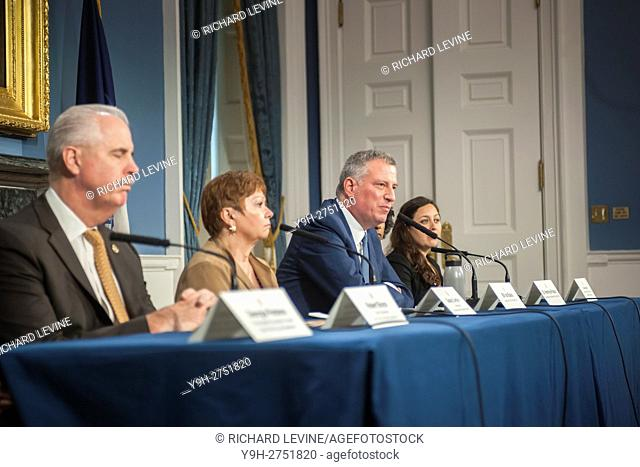 New York Mayor Bill de Blasio, with other members of city government speaks to the media in City Hall's Blue Room on Wednesday, October 5